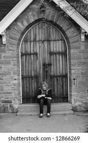 Troubled teen sits on church steps looking for help.
