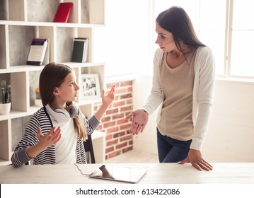 Troubled teenage girl and her mom are quarreling at home
