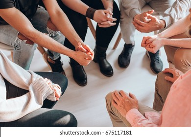 Troubled teenagers meeting with a therapist to solve their issues,psychotherapy concept