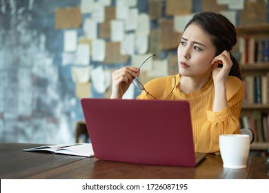 Troubled young asian woman. Remote work. Telework. - Shutterstock ID 1726087195