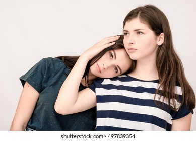 Troubled young girl being consoled by her friend. Friendship help support and difficult times concept.