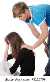 Troubled young girl comforted by her boyfriend. Isolated on white background.