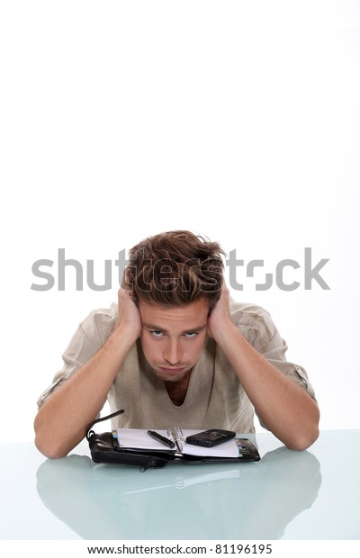 Troubled young man exasperated with his diary
