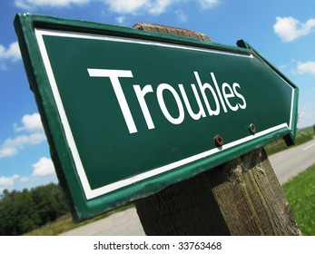 TROUBLES road sign