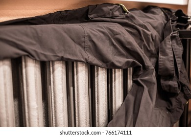 The trousers dried up on  old  cast iron heaters. Iron radiator for home. Central heating battery.