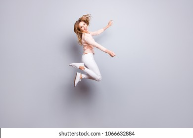 Trousers sneakers pants white pose rejoice exams pass people person concept. Full-size portrait of charming excited crazy mad manager jumping up isolated on gray background copy-space