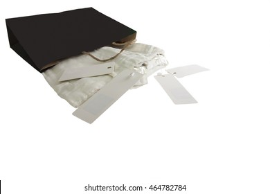 A trousers white jeans pack in a black bag and display black tag label on white isolated, background.