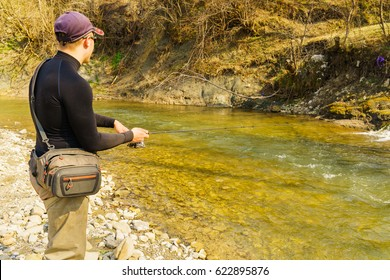 Trout fishing in a mountain river