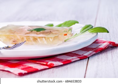 Trout in jelly on a plate. The concept of a healthy diet