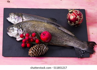 Trout on the plate with holiday decoration