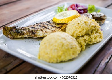 Trout served with corn pudding