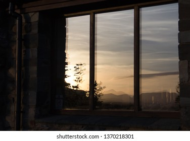 Troutbeck, Cumbria/UK - October 2nd 2014: sunset reflections in cottage window.