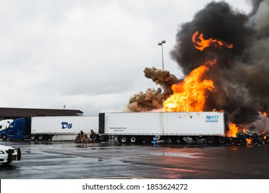 Troutdale, Oregon/USA-11/13/20: Semi truck fire at gas station truck stop along i84. Gresham Firefighters rush to scene to stop exploding gas tanks flames & smoke to rescue people & damaged goods.