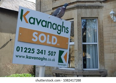 Trowbridge, UK - April 6, 2018: A sold house sign erected by an estate agency is seen outside a house on a town centre street. House prices in the UK are rising gradually despite economy uncertainty.