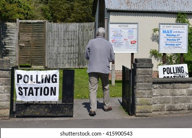 Trowbridge, UK - May 5, 2016:  A voter visits a polling station at a church. Voters are electing members for Scottish Parliament, Welsh Assembly, Northern Ireland Assembly and English Local Councils.