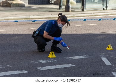 Trowbridge Wiltshire May 12th 2019 A Wiltshire police forensics officer collects evidence from a crime scene