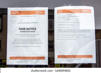 Trowbridge Wiltshire UK January 31 2020 2 legal notices, one a forfeiture, one a torts, displayed for public reading in a closed abandoned shop