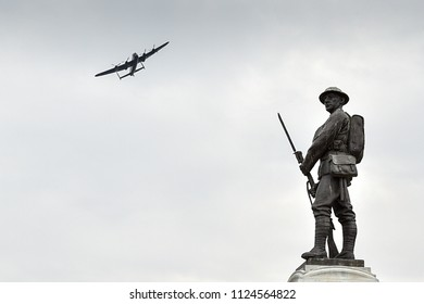 Trowbridge, Wiltshire, UK. July 1st 2018. Lancaster Fly past at the Trowbridge Armed Forces Weekend over the War memorial in Trowbridge park.
