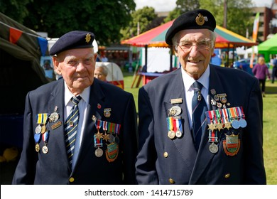 Trowbridge, Wiltshire / UK - June 27 2015: World War 2 Veterans Bob Conway and Gordon Smith from the Normandy Veterans Association at the annual Wiltshire Armed Forces and Veterans Weekend, Trowbridge