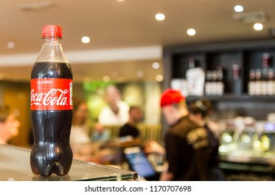 Trowbridge, Wiltshire, UK. Spember 1st 2018. Coca cola bottle on counter with barista in background in Costa coffee. For editorial use ONLY as you can clearly SEE.