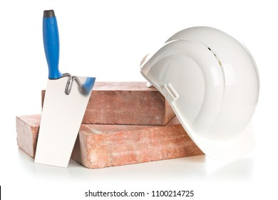 Trowel with bricks and hard hat on white background - home construction or renovation concept