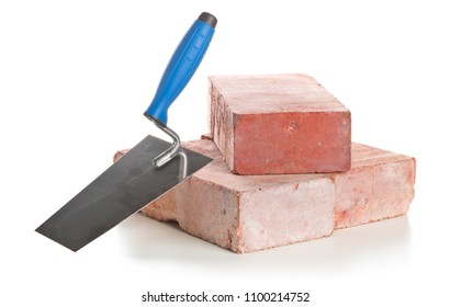 Trowel with bricks on white background - home construction or renovation concept