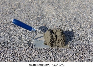 trowel with concrete mix