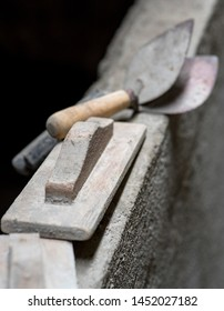 Trowel - Mansion tool used to plaster brick with cement, made of wood and iron.