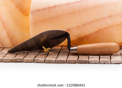 Trowel on the tiles on the background of marble