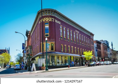 Troy, NY / USA - May 2, 2013: Shops and brown stone buildings in the city of Troy in Upstate New York.
