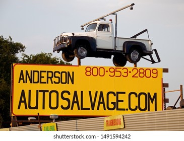 Troy, Texas / USA - July 2 2009: Elevated Tow Truck Signage for Auto salvage.