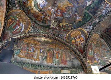 TROYAN, BULGARIA - APR 14, 2019 - Frescoes of saints cover the interior walls of the Stauropegial Troyan monastery ,Troyan, Bulgaria