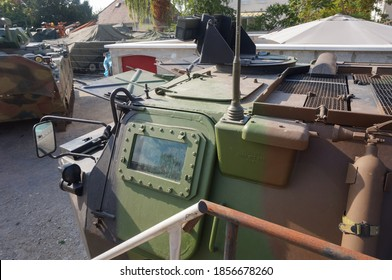 Troyes, France -Sept. 2020 - Top view over the front of a retired VAB, an armored personnel carrier manufactured by Giat for the French Army, featuring a thick bulletproof window and a rearview mirror