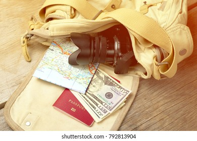 trraveller's set in bag - passport, money, photo camera and folded map, toned