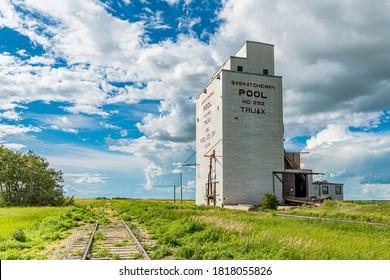 Truax, SK/Canada- July 18, 2019: The abandoned vintage Wheat Pool grain elevator in Truax, Saskatchewan with railway tracks beside it