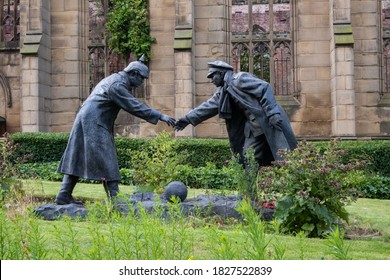 The Truce sculpture by Andy Edwards in the gardens of the Bombed Out Church in Liverpool July 2020