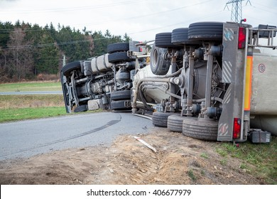 Truck accident. Truck lies on the road after incident.
