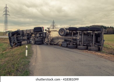 Truck accident. Truck lies on the road after incident. Insurance companies concept.