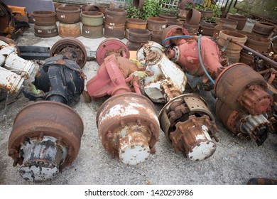Truck axles and other parts, awaiting to be used again or to recycling, in a vehicle graveyard, Kozani, Greece.