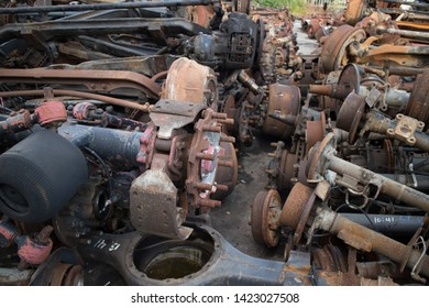 A lot of truck axles and other parts, awaiting to be used again or to recycling, in a vehicle graveyard, Kozani, Greece.