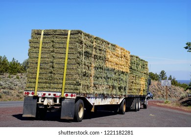 Truck with bales of hay on highway through the High Desert between Bend and Burns, Oregon