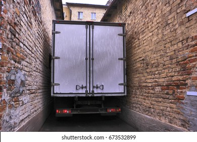 Truck between passing in a narrow street in the old city of St.
