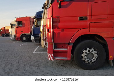 Truck cabins in the parking lot are in line.