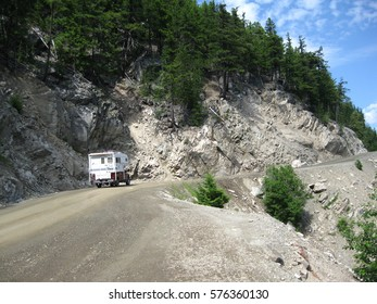 Truck and camper on mountain highway