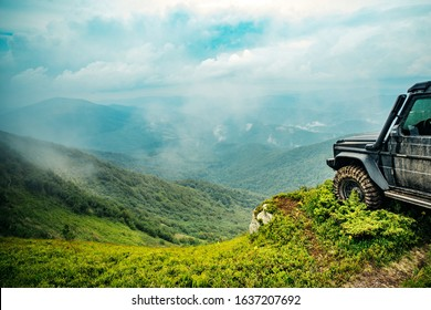 Truck car wheel on offroad steppe adventure trail. Off road vehicle coming out of a mud hole hazard. SUV race on dirt. Extreme off road tour in a forest