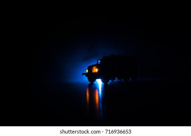 Truck in the conflict zone. The war in the countryside. War vehicle silhouette at night. Battle scene. War concept