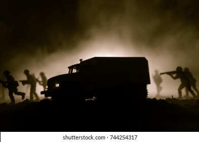 Truck in the conflict zone. The war in the countryside. War vehicle silhouette at night. Battle scene. War concept. Selective focus