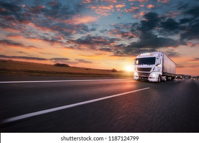 Truck with container on highway, cargo transportation concept, shaving effect.