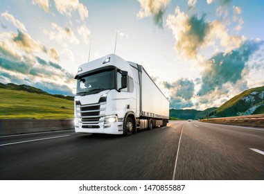 Truck with container on highway, cargo transportation concept. Shaving effect. - Shutterstock ID 1470855887
