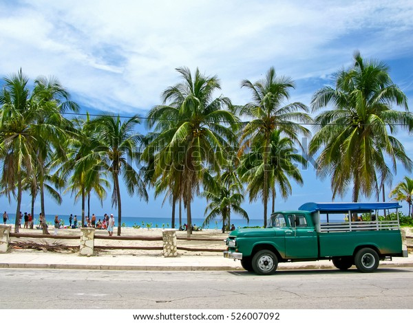 Truck converted under the bus parked on the beach. Sunny afternoon in Cuba.